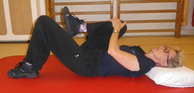 Lage rug en bekken mobiliteit oefening 2a: Knie naar borst
